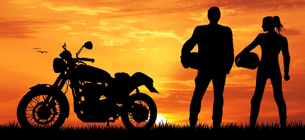 motorcycle rider admiring sunset with partner